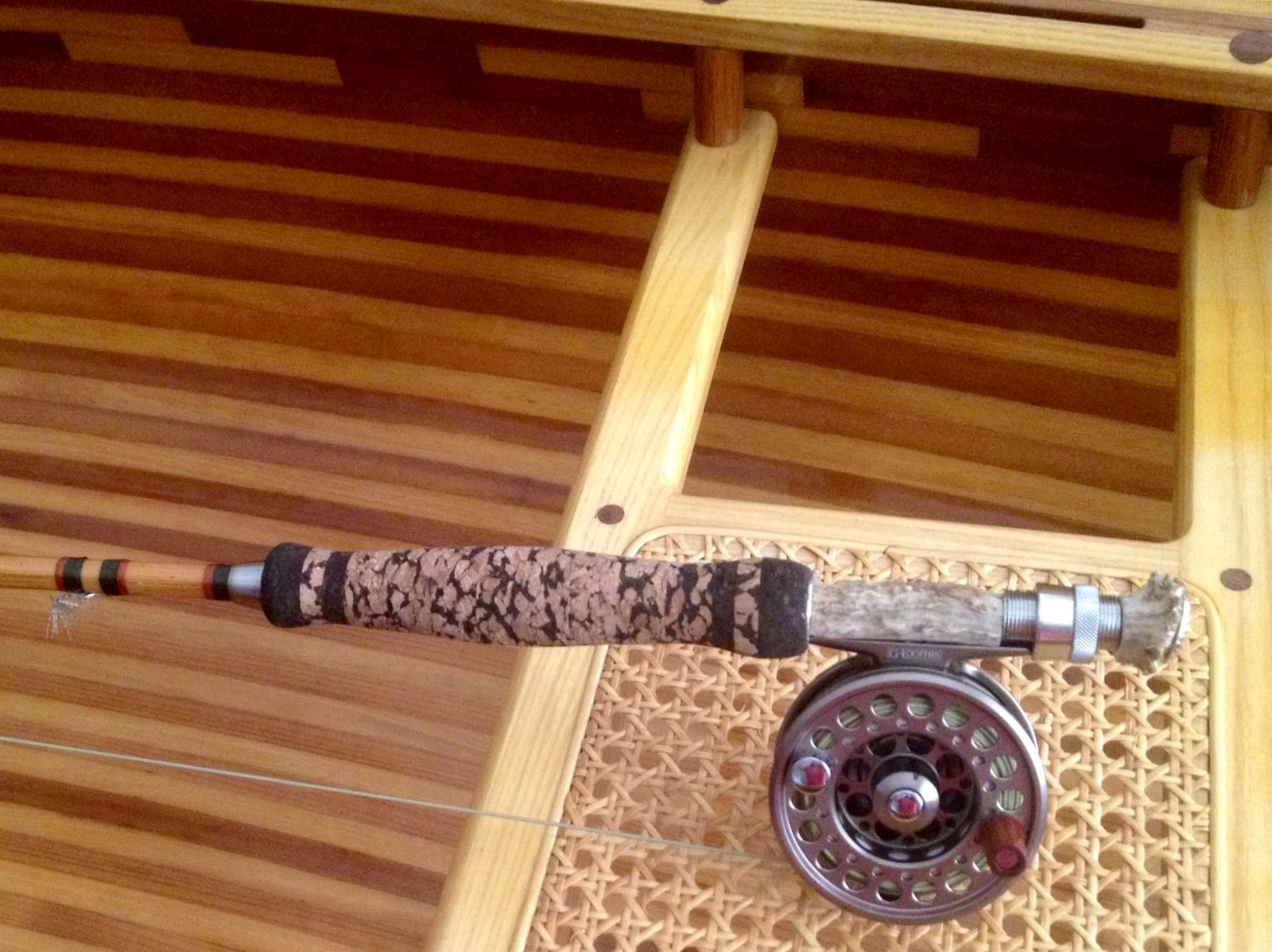 Bamboo fly rod with deer antler reel seat.